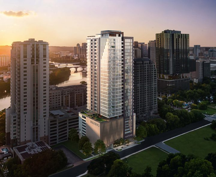 aerial view of Natiivo Austin 33-story building exterior at sunset with views of Colorado River Lady Bird Lake